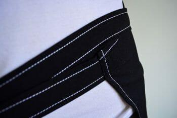 White Stitched Black Apron